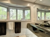 15. Georgian-Bay-Cottage-Honey-Harbour-Master-Bathroom-Facing-Windows-And-Forest-View