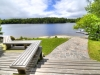 25. Georgian-Bay-Cottage-Honey-Harbour-Facing-Deck-Steps-To-Flagstone-Walkway-To-Dock-And-Inland-Channel