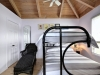 32. Georgian-Bay-Cottage-Honey-Harbour-Interior-Bedroom-Facing-Chaise-Lounge-Bunk-Bed