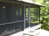 MLS® 20090235 Sans Souci Cottage Sold By Rick Hill: Facing Side Porch Forest