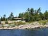 MLS® 20090235 Sans Souci Cottage Sold By Rick Hill: Facing Barefoot Granite Shoreline Juniper Forest And Wind Swept Pines