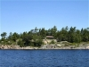 MLS® 20090235 Sans Souci Cottage Sold By Rick Hill: Facing Rocky Granite Shoreline And Windswept Forest