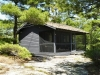 MLS® 20090235 Sans Souci Cottage With Cabin Sold By Rick Hill: Facing Front Outcropping And Forest