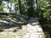 MLS® 20090235 Sans Souci Property Sold By Rick Hill: Facing Flagstone Path With Barefoot Granite Outcropping And Forest
