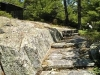 MLS® 20090235 Sans Souci Property Sold By Rick Hill: Facing Stone Steps Beside Granite Boulder