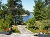 MLS® 20090235 Sans Souci Cottage Sold By Rick Hill: Facing Flagstone Patio Barefoot Granite Path To Georgian Bay