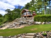Georgian-Bay-Honey-Harbour-Luxury-Cabin-On-Hill-Of-Granite-Outcropping-With-Lawn-Forest