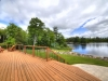 Georgian-Bay-Honey-Harbour-View-From-Cottage-Front Deck-Steps-With-Railing-And-Walkway-Lawn-Forest-And-Inland-Waterway