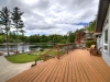 Georgian-Bay-Honey-Harbour-View-From-Cottage-Front-Deck-With-Railing-Facing-Walkway-To-Dock-Lawn-Flagpole-Cove