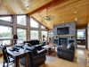 Honey-Harbour-Georgian-Bay-Cottage-Facing-Interior-Living-Room-Desk-Siting-Area-Fireplace-Giant-Screen-TV
