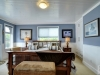 Honey-Harbour-Georgian-Bay-Cottage-Facing-Interior-Office-Study-With-Large-Wood-Desk-And-Walk-out-To-Deck