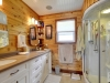 Honey-Harbour-Georgian-Bay-Cottage-Facing-Interior-Paneled-Bathroom-Vanity-With-Arcing-Shower