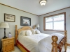 Honey-Harbour-Georgian-Bay-Cottage-Interior-Bedroom-Facing-Large-Cannonball-Bed