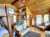 Honey-Harbour-Luxury-Cottage-Interior-Bedroom-Facing-Bunk-Bed-With-Sitting-Area-Woodstove
