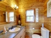 Honey-Harbour-Luxury-Cottage-Interior-Facing-Bathroom-Wood-Paneling-Theme-Vanity
