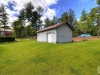 Honey-Harbour-Single-Storey-Cabin-Workshop-With-Manicured-Lawn-Forest