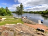 Honey-Harbour-Waterfront-Georgian-Bay-Luxury-Cottage-Facing-Granite-Outcropping-Beach-Lawn-Docks-And-Inland-Waterway