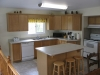 480150357-Honey-Harbour-South-Bay-Road-Access-Georgian-Bay-Cottage-For-Sale-08-Kitchen-Dining-Area-Wood-Cabinets